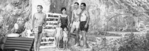 Mrs. Jacqueline Kennedy, her four-year-old daughter Caroline, left, and two-year-old newphew Anthony Radziwill, shown next to a ìWelcome Jacquelineî poster at the first beach outing of their Italian vacation at Ravello, Italy on August 9, 1962. Mrs. Kennedy wears a pea-green, one-piece bathing suit. (AP Photo/Girolamo Di Majo)